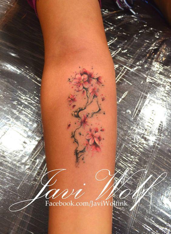Javi Wolf cherry blossom watercolor tattoo on forearmjavi wolf
