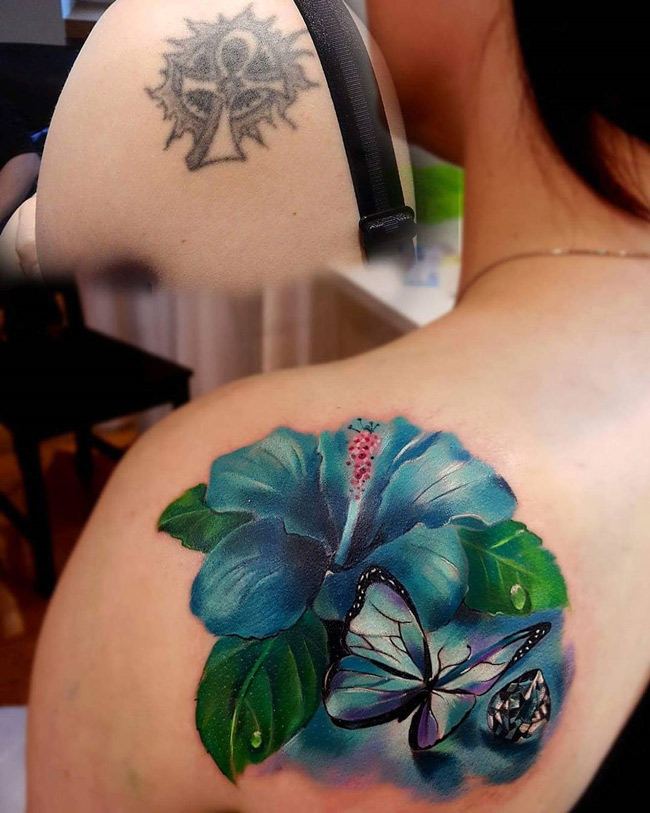 Awesome 3D Hibiscus And Butterfly Tattoo On Shoulder