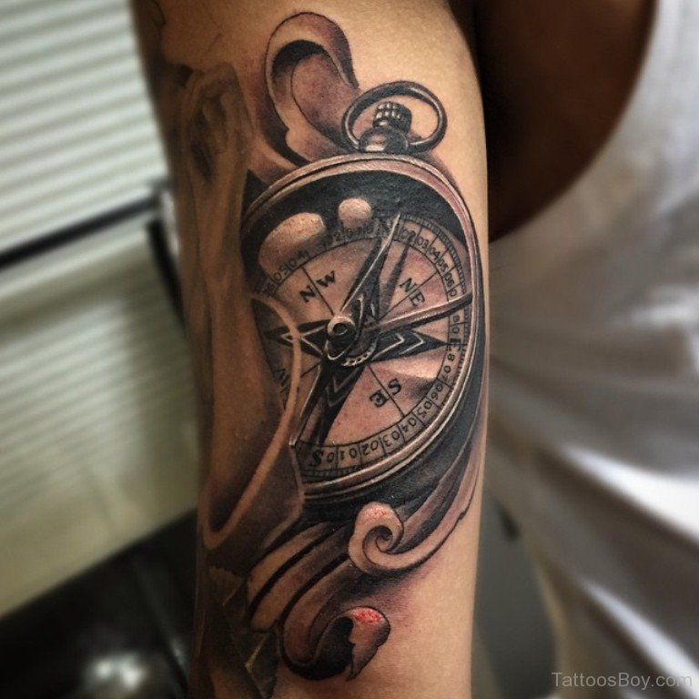 Black and grey compass tattoo on left half sleeve