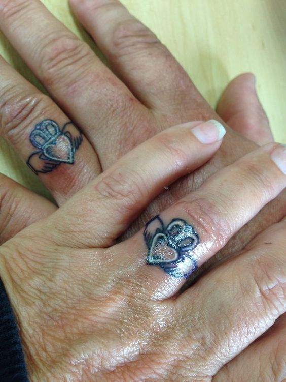 Claddagh tattoo images designs for Ring finger tattoos for couples