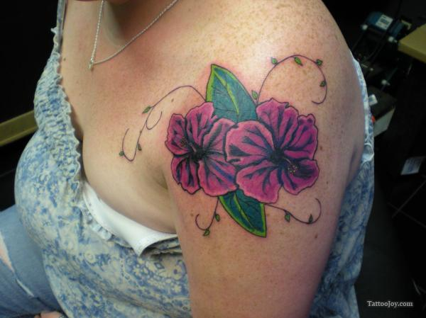 Color Ink Hibiscus Tattoo On Girl Shoulder