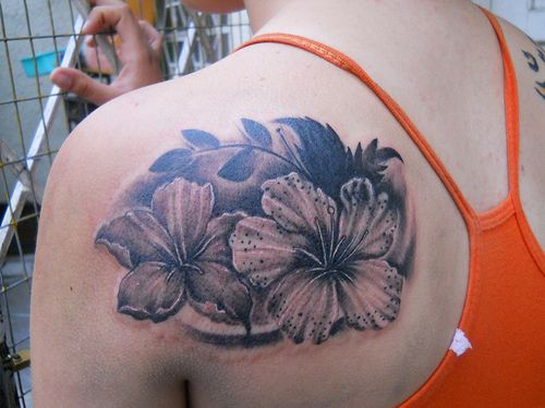 Cool Black And Grey Hibiscus Tattoo On Girl Back Shoulder