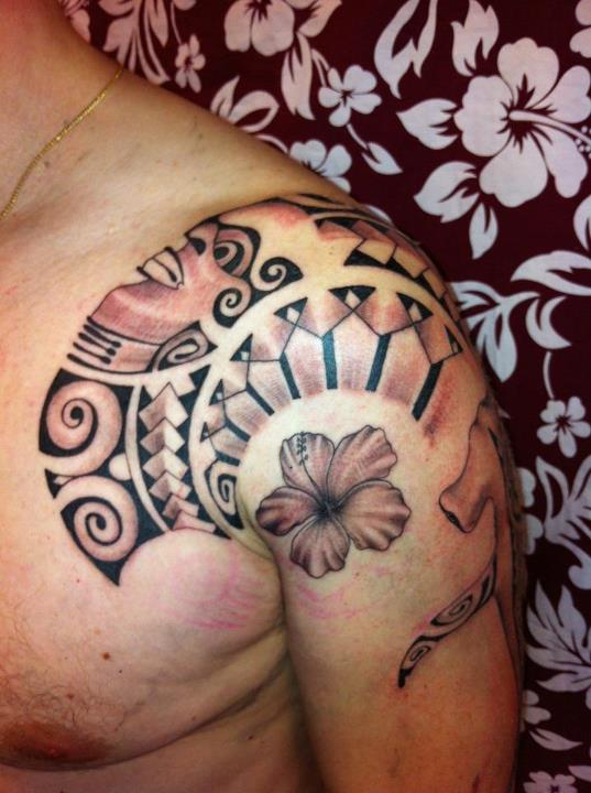 Cool Polynesian Hibiscus Tattoo On Shoulder For Men