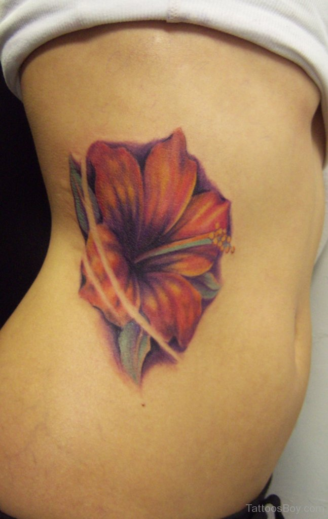 Hibiscus Flower Tattoo On Girl Side Rib