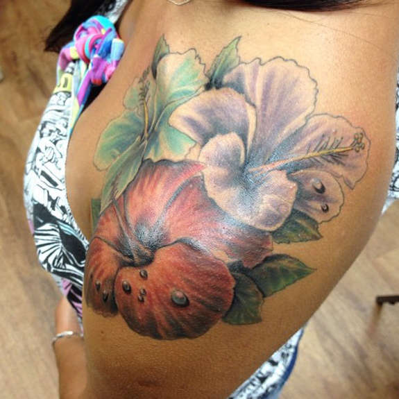 Multicolor Hibiscus Tattoo On Upper Shoulder