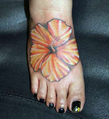 Orange Hibiscus Flower Tattoo On Right Foot