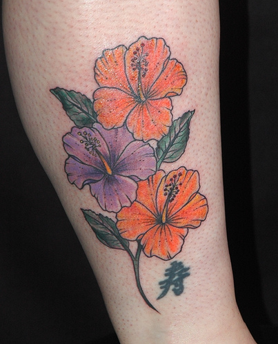 Tropical Flower Rib Tattoos: Hibiscus Tattoo Images & Designs