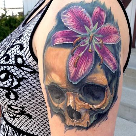 Realistic Hibiscus And Skull Tattoo On Girl Shoulder