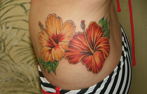 Red And Yellow Hibiscus Tattoo On Hip For Girls