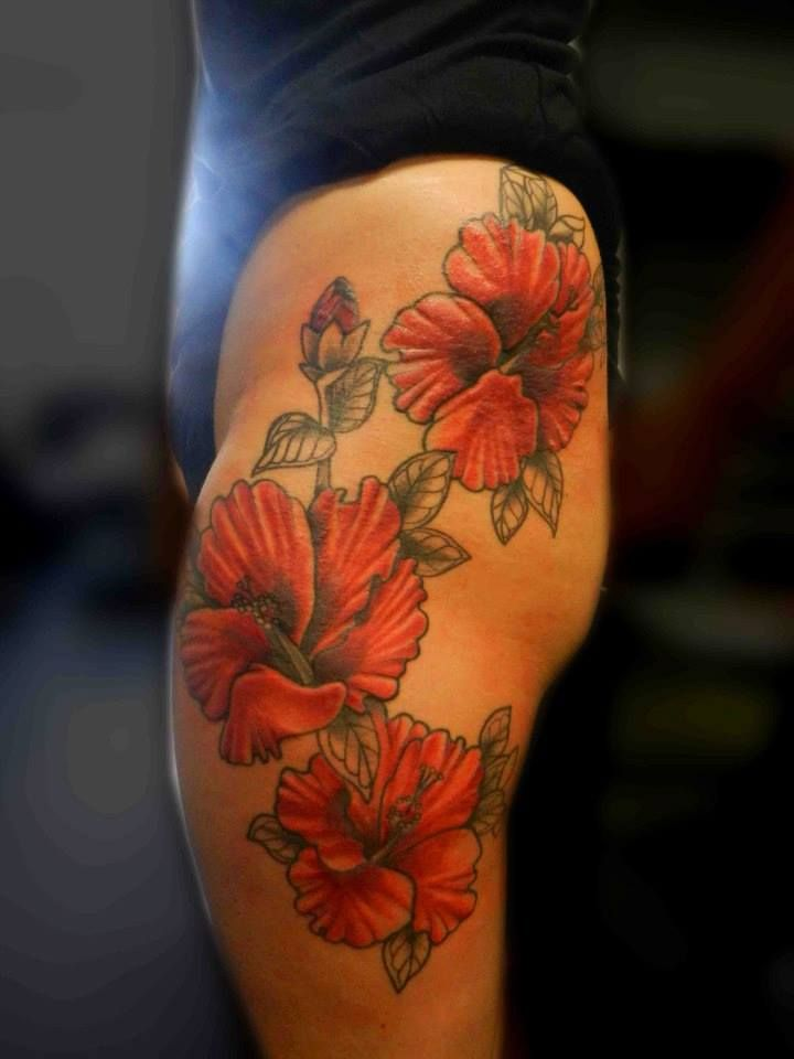 Red Hibiscus Flower Tattoo On Girl Thigh