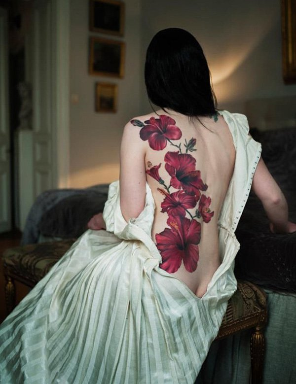 Red Hibiscus Tattoo On Girl Back