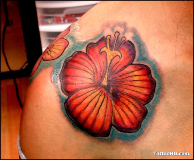 Red Hibiscus Tattoo On Left Shoulder