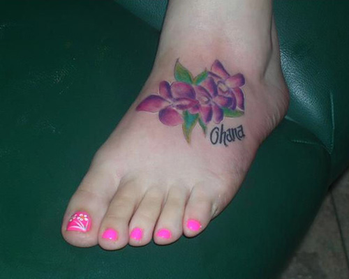 Simple Name With Hibiscus Tattoo On Girl Left Foot