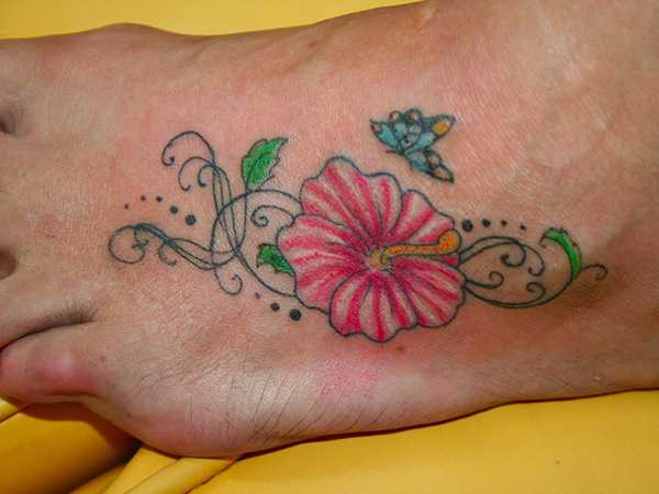 Small Butterfly With Hibiscus Tattoo On Foot