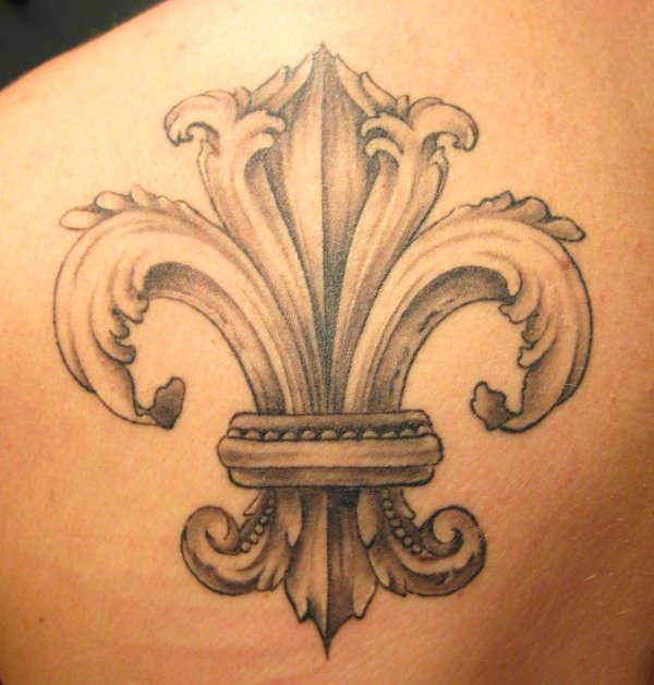 Stylish Fleur De Lis Tattoo On Upper Back