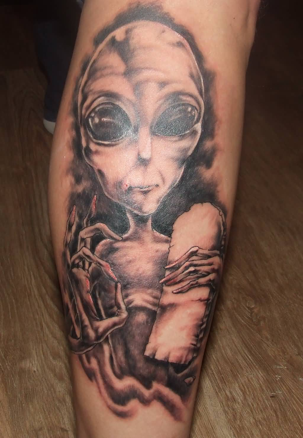 Awesome Grey Ink Alien Tattoo On Leg
