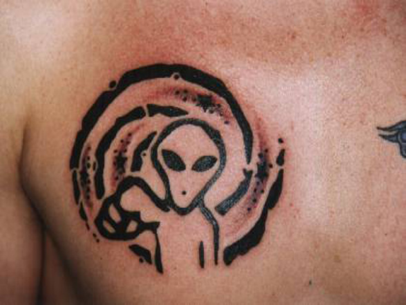 Black Outline Alien Tattoo On Man Chest