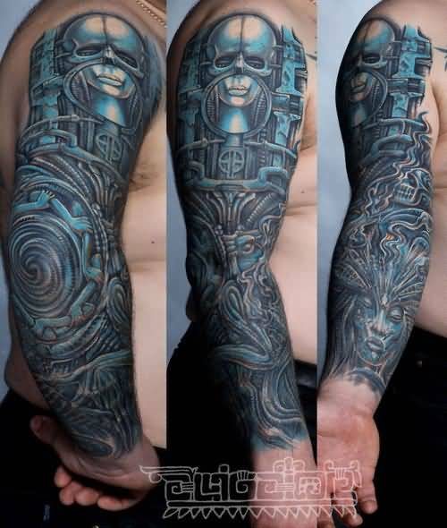 Colored Small Alien Head Tattoo On Man Full Sleeve