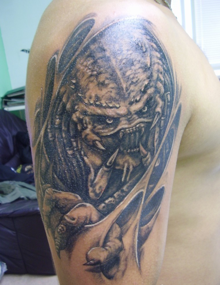 Grey Ink Alien Tattoo On Man Right Half Sleeve