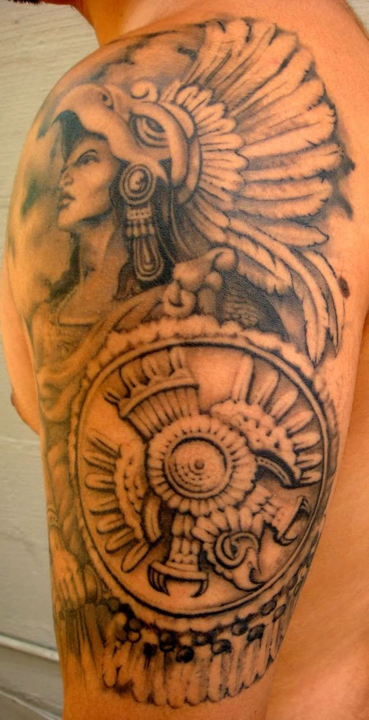 Grey Ink Aztec Tattoo On Man Left Half Sleeve