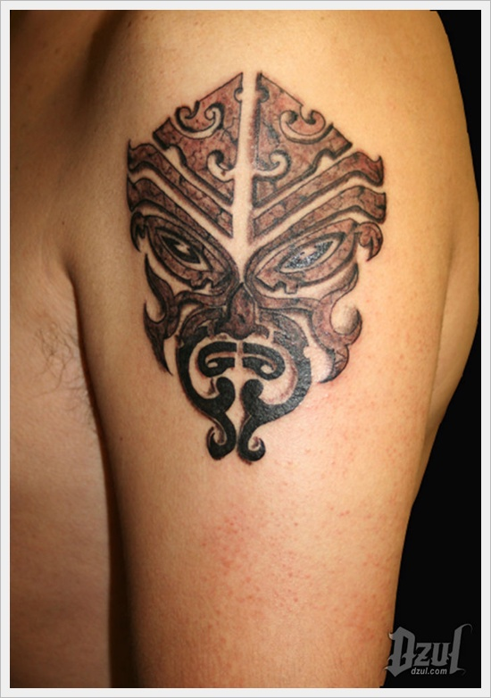 Grey Tribal Mask Tattoo On Left Shoulder