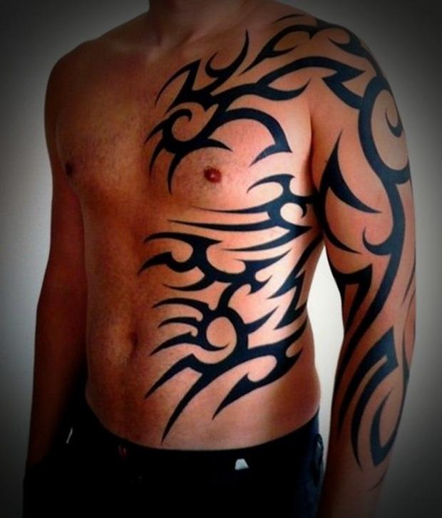 Man Right Half Sleeve And Side Rib Tribal Tattoo