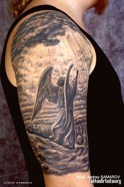 Realistic Angel Tattoo On Man Right Half Sleeve