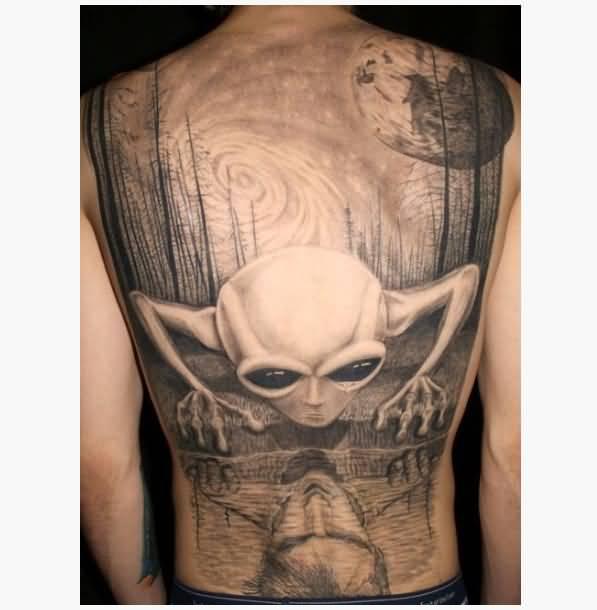 Realistic Grey Small Alien Head Tattoo On Man Full Back