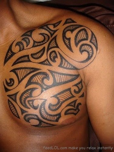 Tribal Tattoo On Man Front Shoulder