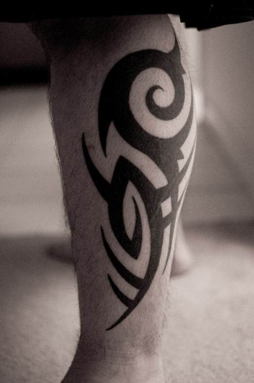 Tribal Tattoo On Side Leg For Men