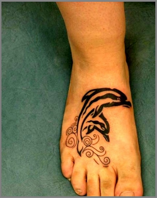 Black Tribal Dolphin Tattoo On Right Foot