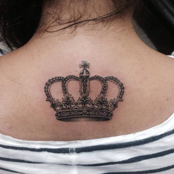 Grey Ink Crown Tattoo On Girl Upper Back