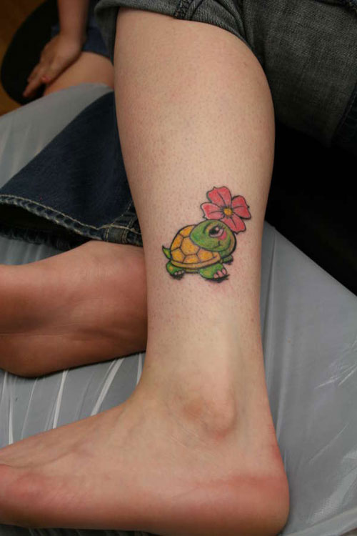 Nice Flower And Turtle Tattoo On Leg