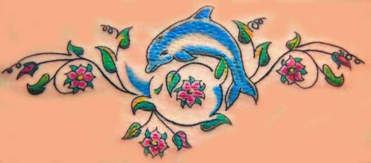 Nice Red Flowers And Blue Dolphin Tattoo