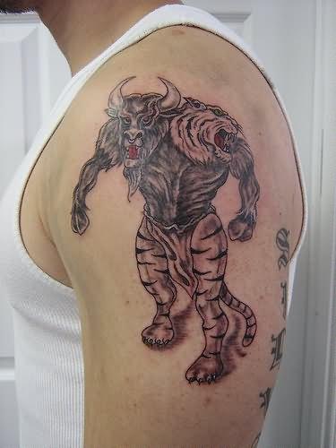 devil bull tattoo on shoulder