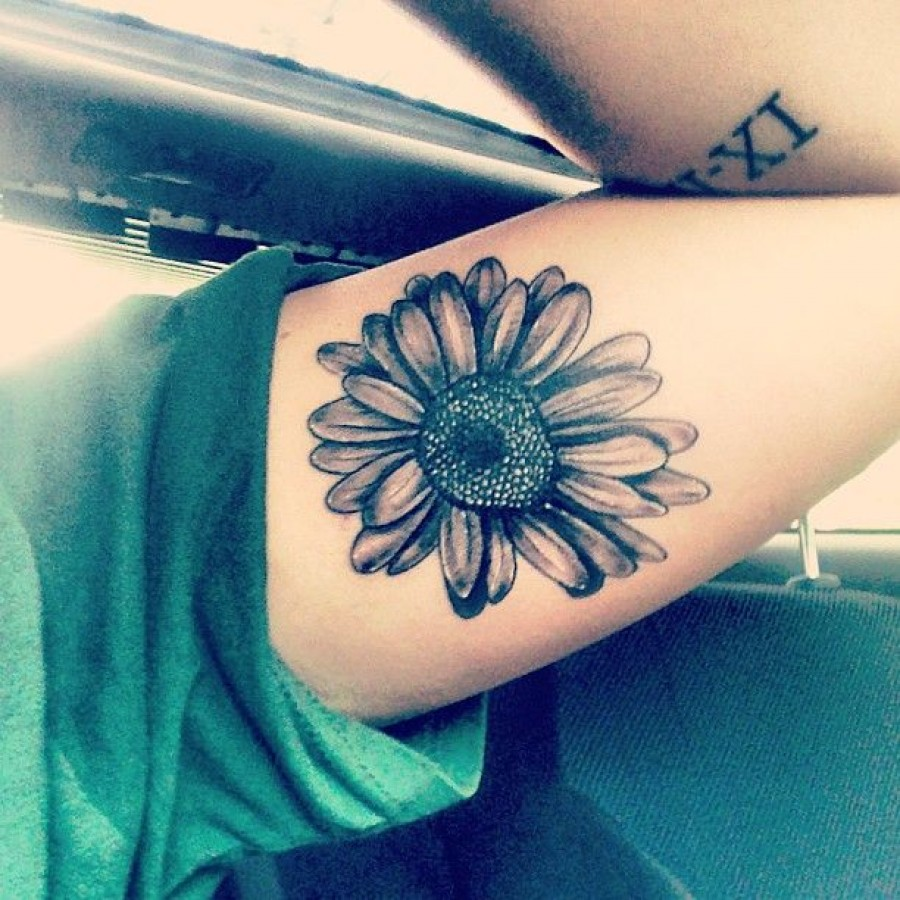 Grey Ink Daisy Tattoo On Inner Bicep