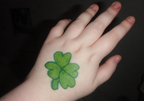 Left Hand Green Clover Tattoo Idea