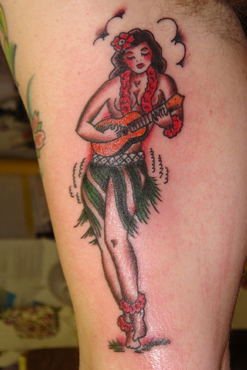 Pinup Girl With Small Guitar Tattoo On Bicep