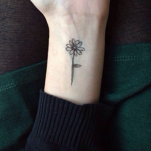 Simple Daisy Tattoo On Left Wrist