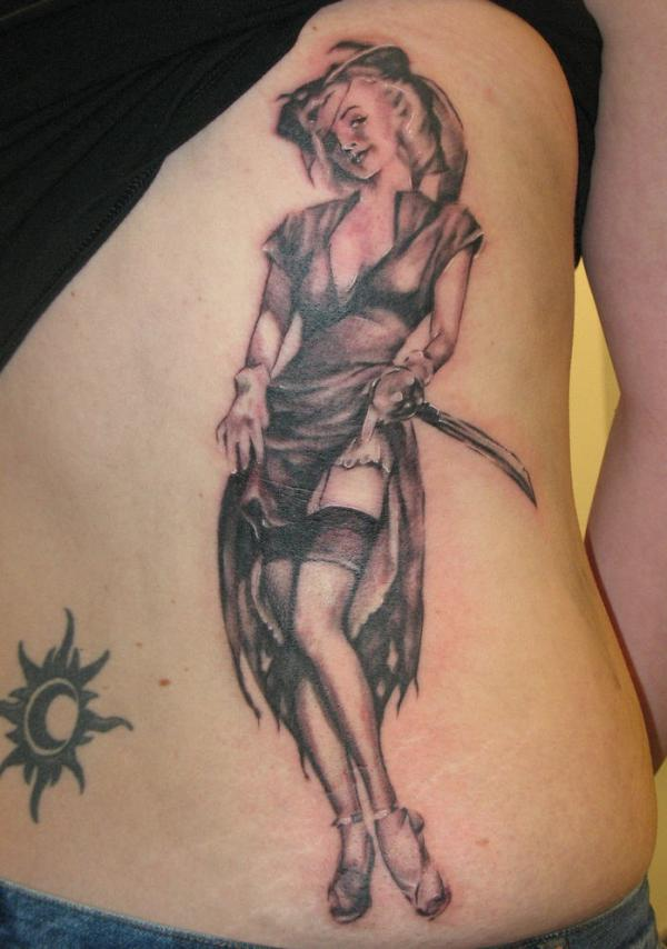 Tribal Sun And Pinup Girl Tattoo On Back