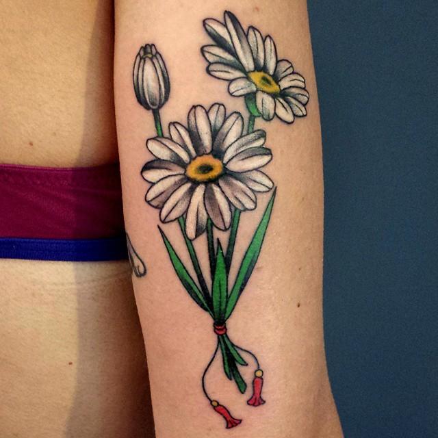 White daisy flower tattoo on bicep mightylinksfo