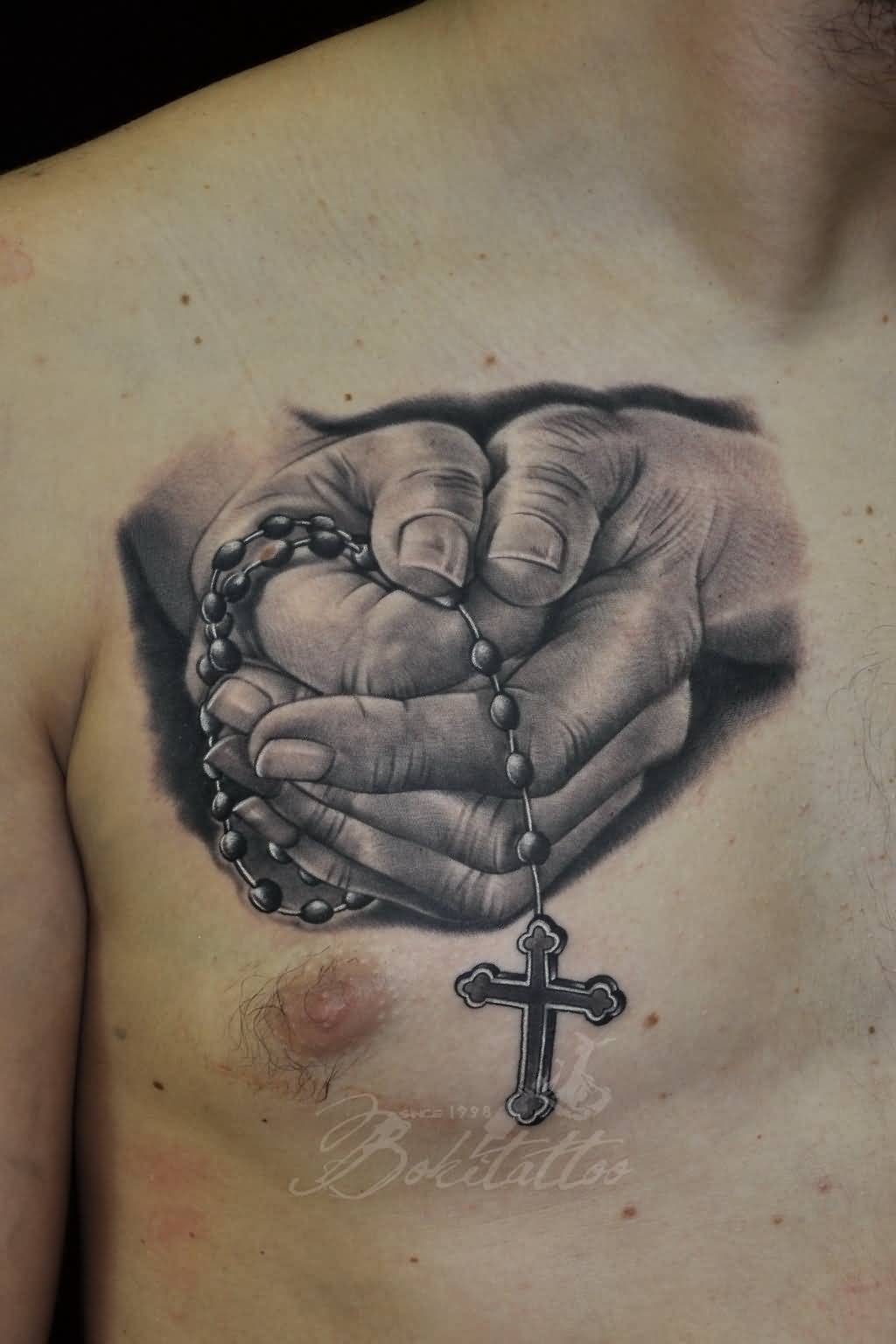 Black and grey praying hands tattoo on chest for Black and grey chest tattoos