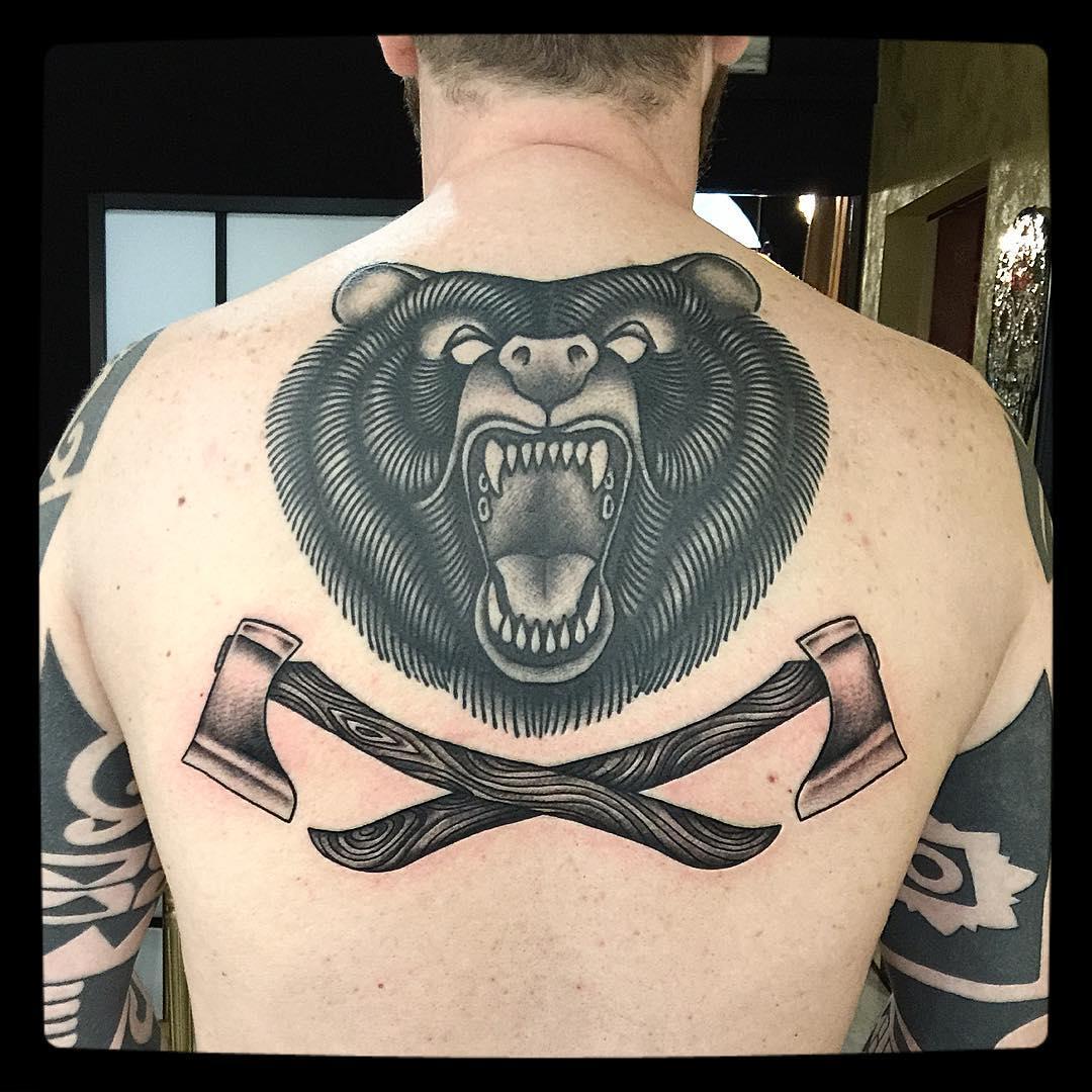 Black Ink Bear Head Tattoo On Upper Back