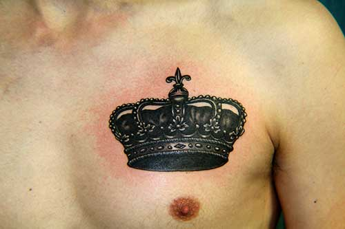 Black Ink King Crown Tattoo On Man Chest