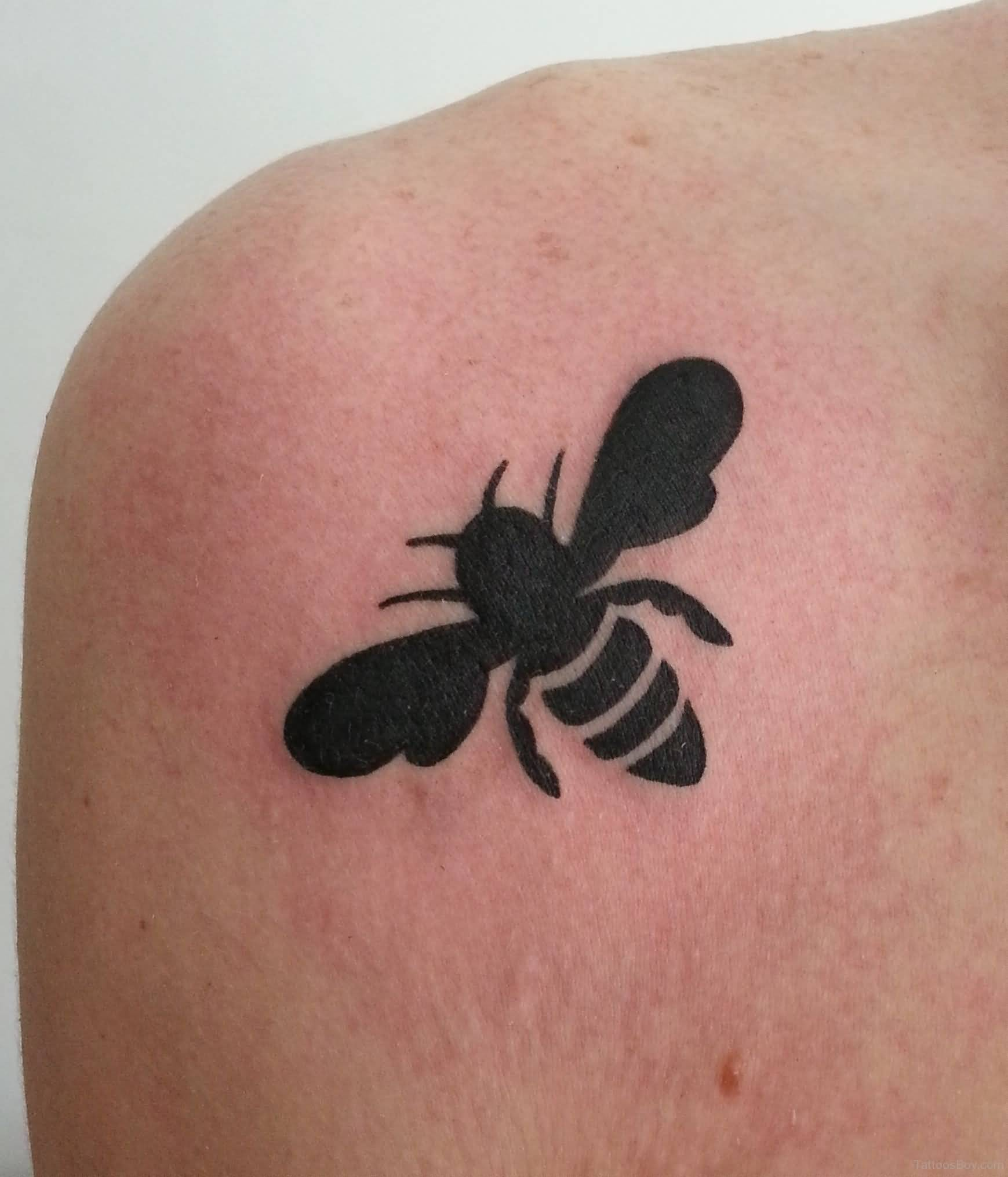 Black Silhouette Bee Tattoo On Back Shoulder