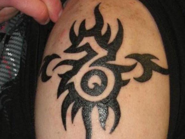 Black Tribal Capricorn Tattoo On Man Left Shoulder