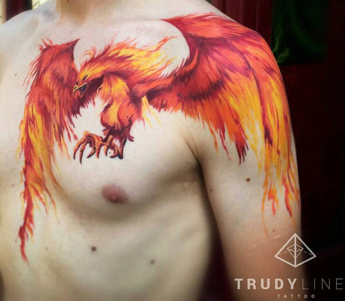 Flying Colored Phoenix Tattoo On Front Shoulder