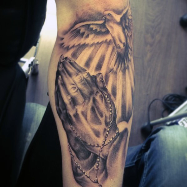21ab2646ad518 Flying Pigeon And Praying Hands Tattoo On Arm Sleeve