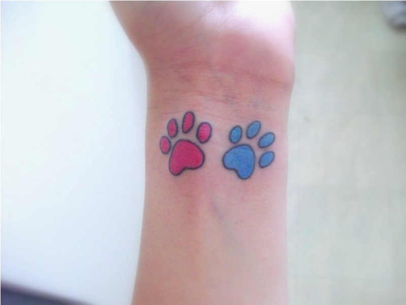 Pink And Blue Paw Tattoos On Wrist