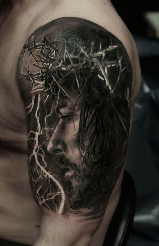 Realistic Jesus Tattoo On Man Left Half Sleeve